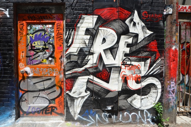 graffiti on a wall, and orange door with graffiti and stickers, Graffiti Alley