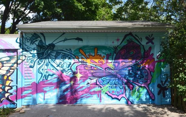 two large butterflies in a mural by @oriah_scott