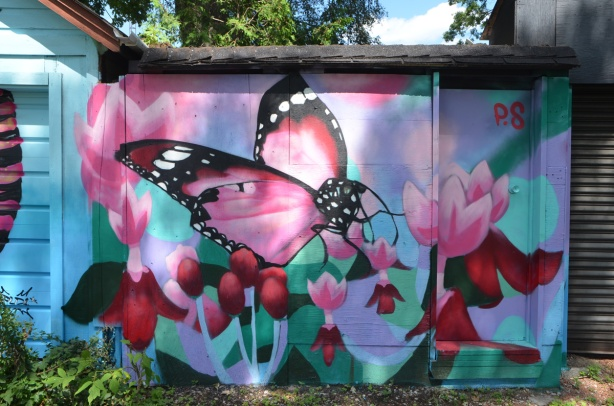large pink butterfly with pink and red flowers by P.S.