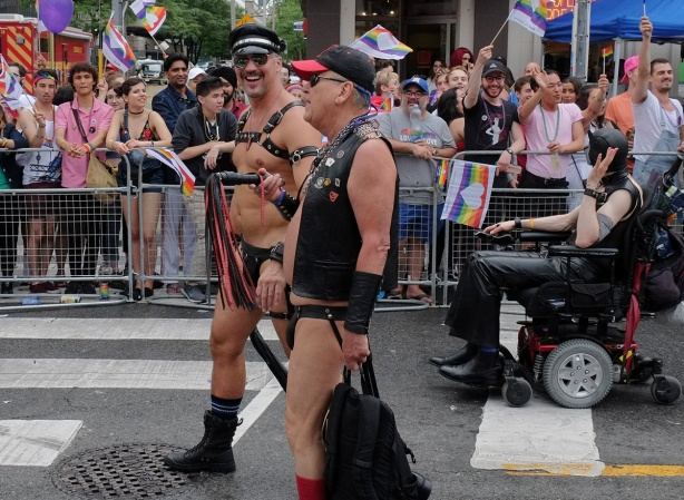 men in leather but no clothes walking in parade