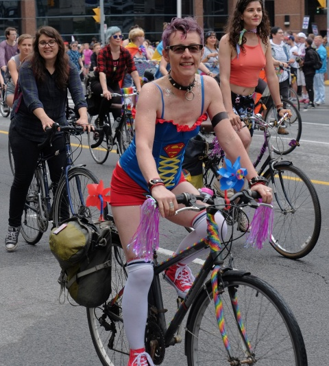 dyke march 2018, dykes on bikes - in a corset with super woman insignia