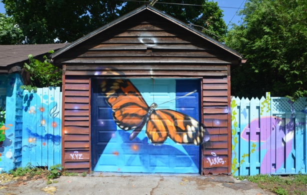 monarch butterfly painted on a garage door