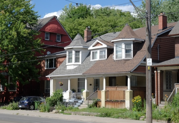a semi divided house on bathurst street both with small turrets above upper floor bay windows