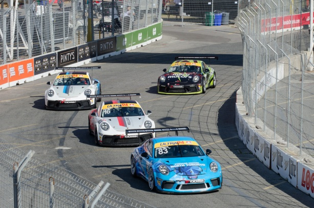 four porsche race cars on the race track at Honda Indy