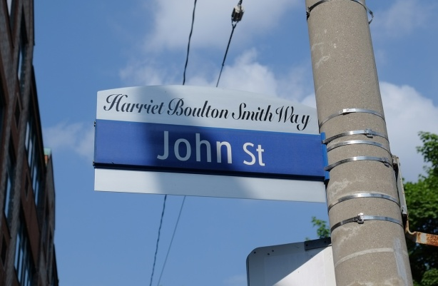 Toronto street sign for John Street, also called Harriet Boulton Smith Way