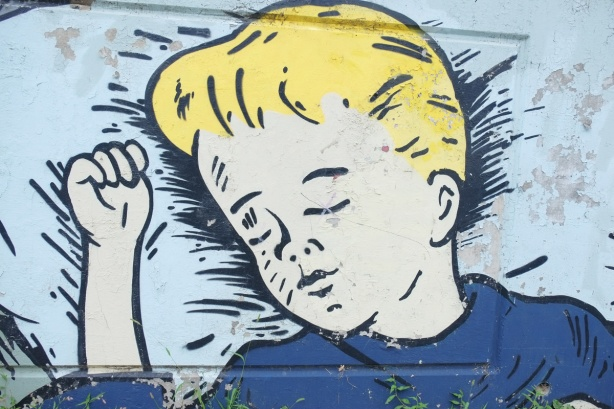 mural, large painting of a blond boy sleeping, head on pillow, head and shoulders only
