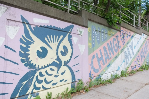 mural, large blue and white owl, with words in large letters that say no change my heart