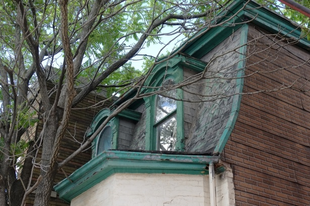 green trim around roof and windows of an old house