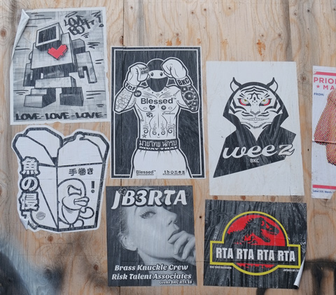 paste ups on plywood hoardings,