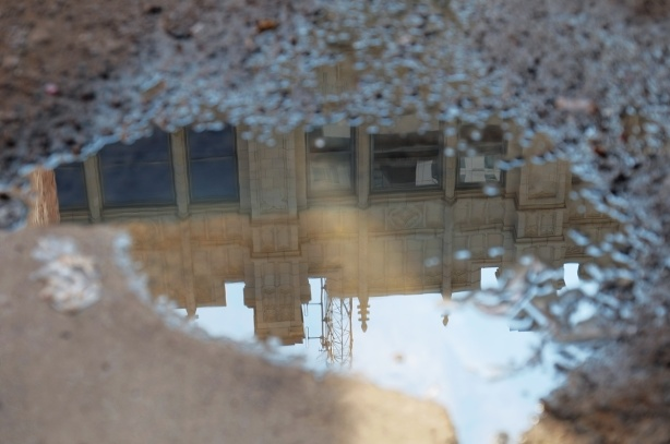 reflections of City TV building in a puddle