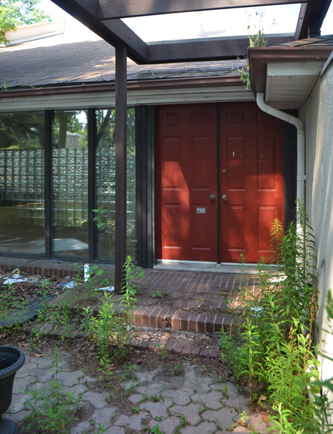 double red doors, front entrance way to an empty modern design house