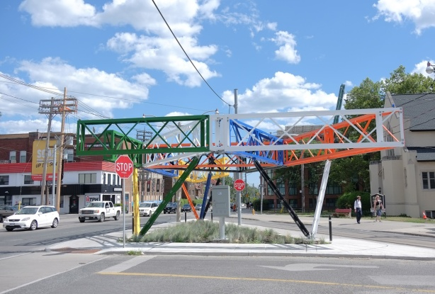 Three Points Where Tao Lines meet, a public art sculpture in bright colours, metal grid like construction cranes, by Daniel Young and Christian Giroux at the intersection of Bathurst and Vaughan.