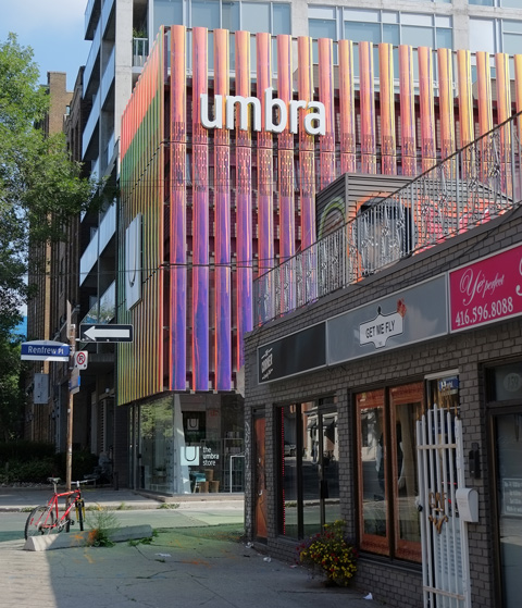 building, umbra store, vertical lines on exterior of a material that changes colour depending on the light