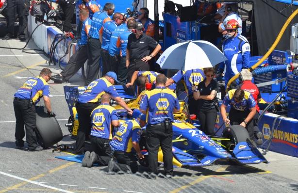 standing around a race car pre-race