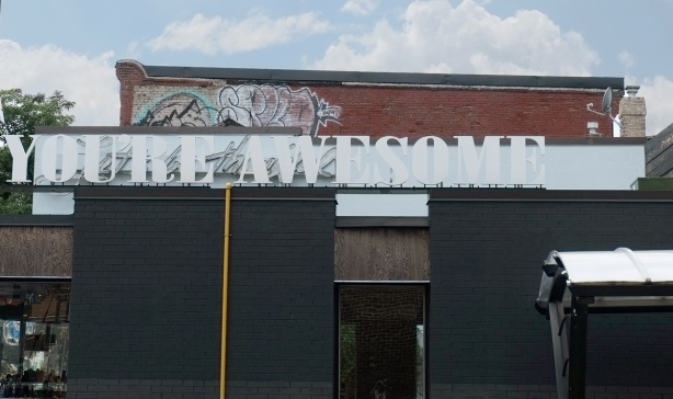 large white letter across a roof line that say you're awesome