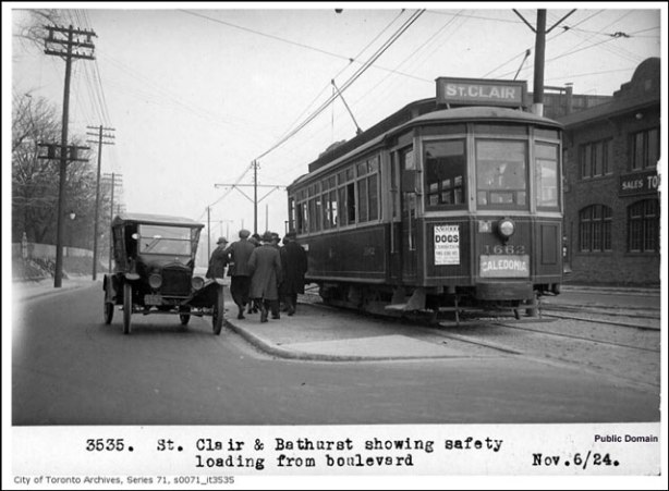 vintage black and white photo from 1924 of a streetcar on the St. Clair line stopped at Bathurst to pick up passengers.