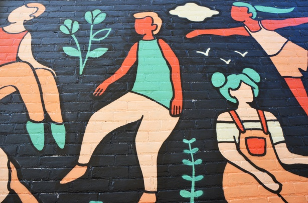 part of a mural by Emily May Rose of dancing female figures on a black background