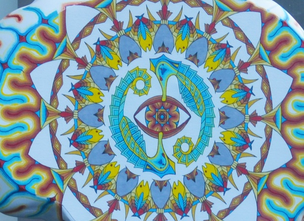 close up of painting on brain shaped sculpture, called Mids Eye by David Bagley, circular pattern of fish and seahorses