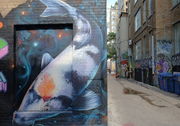 a large carp mural by Nick Sweetman in Graffiti Alley