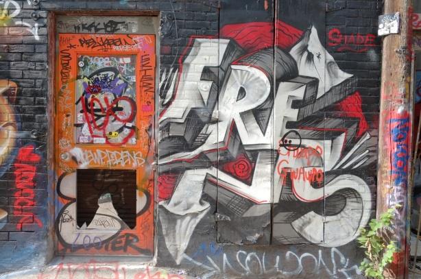 orange door and street art in Graffiti Alley