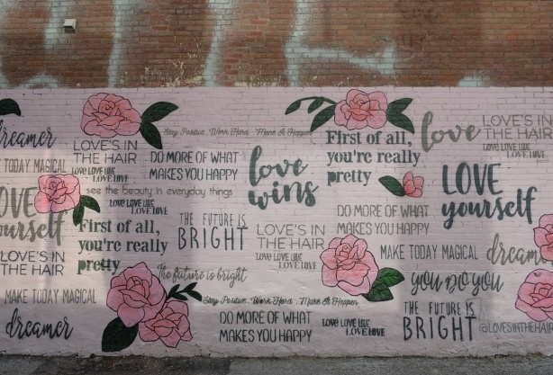 pink roses and words about love on a mural