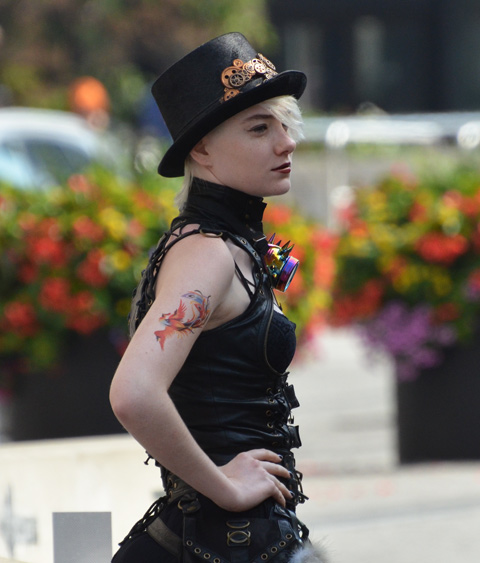 woman in black leather and tophat