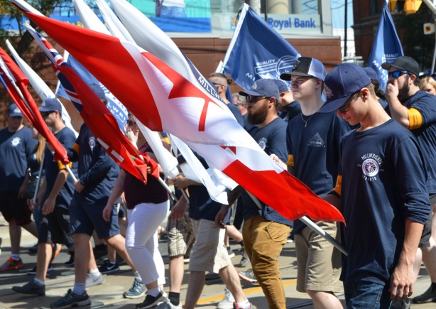 millwrights union members carrying flags