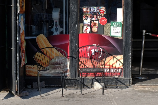 two metal chairs outside a churros place