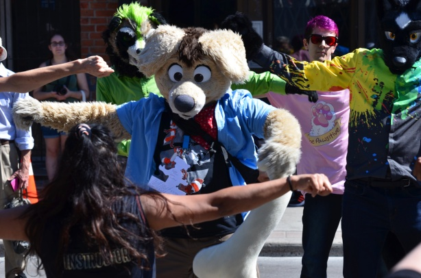 people in life size animal costumes including heads, dance along in a fitness session on Yonge street during Open Streets