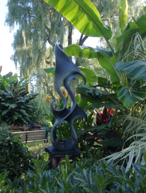 black stone sculpture called free flow in Edwards Gardens.