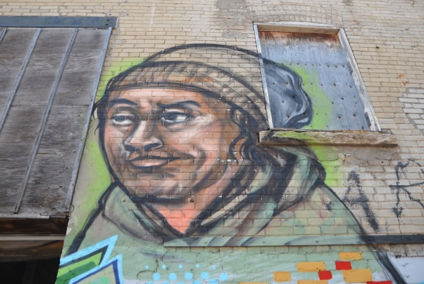 elicser painting of a man in a brown toque