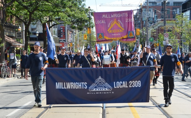 millwrights local 2309 walk with their banner in a labour day parade