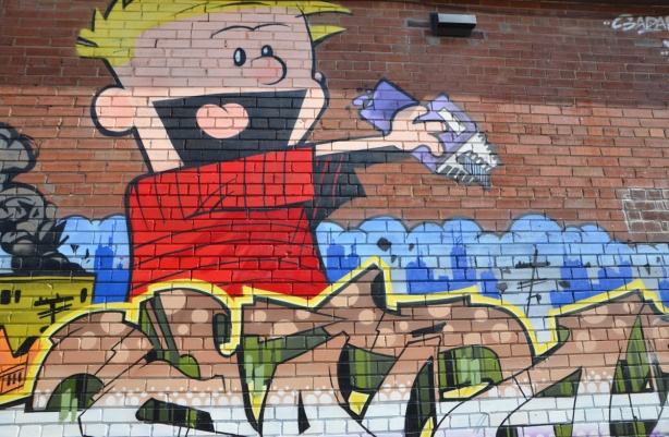 in a popart mural by Matt Gondek and Jackson, in an alley, calvin from Calvin and Hobbes cartoon