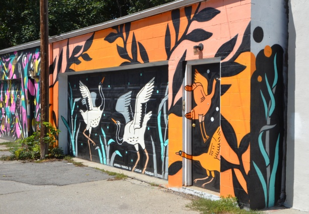 alley mural on a garage, herons and geese,