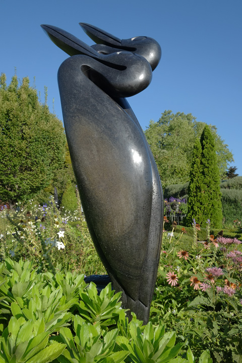 tall black sculpture at Edwards Gardens