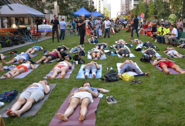 doing yoga on grass laid down on the street, Bloor Street, temporary park for Open Streets