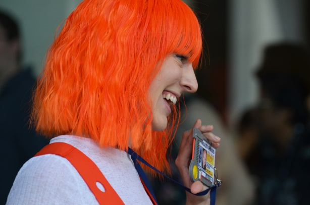 a woman with a bright orange wig