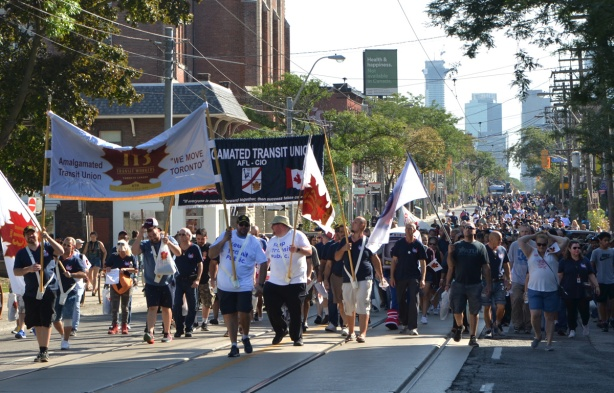 amalgamated transit workers union march in labour Day parade on Queen St West,