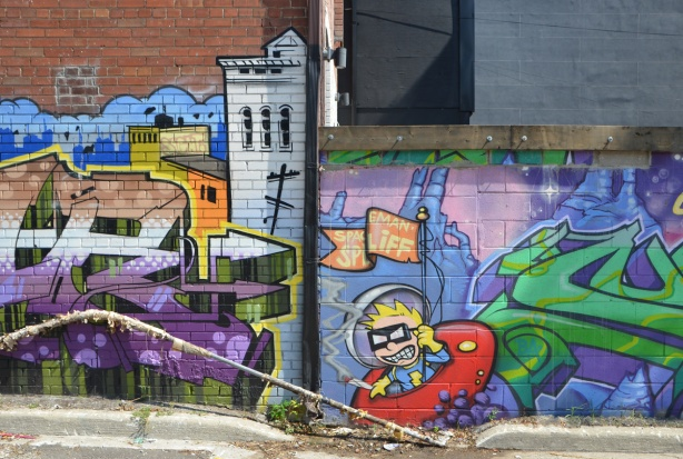 spaceman spliff in a popart mural by Matt Gondek and Jackson, in an alley