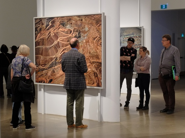 people viewing large coloured photos by Edward Burtynsky at the Art Gallery of Ontario