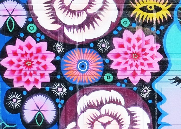 close up of stylized flowers in a mural in pinks and blues