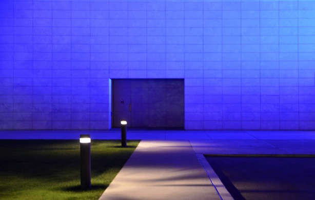 side of the Aga Khan museum lit in bluish purple light