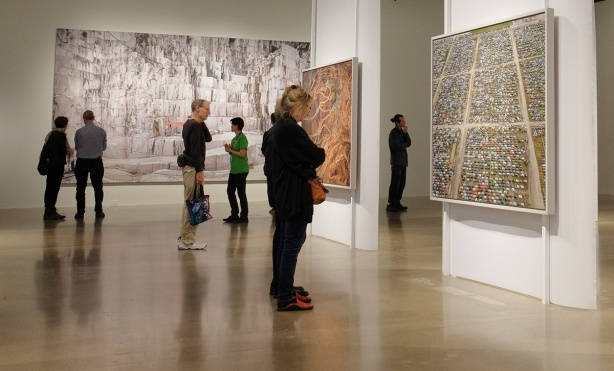 people viewing art exhibit at AGO, photos by Edward Burtynsky