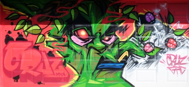 mural by cruz 1, green angry face