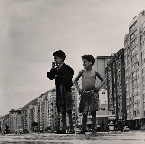 two boys in front of a row of apartment buildings, photo by Gorodn Parks