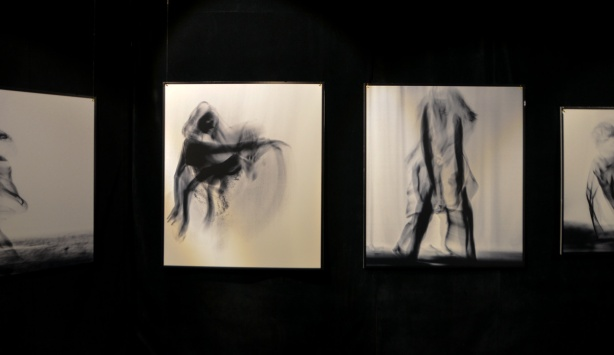 four photographs on a black wall, by zahra Saleki, figures in motion