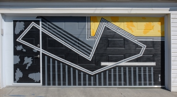 graphic looking design painted on a garage door in black and yellow with grey lines, by nixo