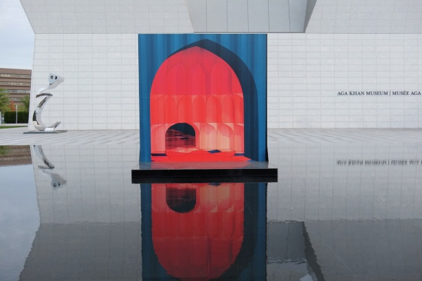 a painting called The Encompassment stands in a reflecting pool in front of the Aga Khan Museum.  Painted by Javid Jah, blue arch over red entranceway
