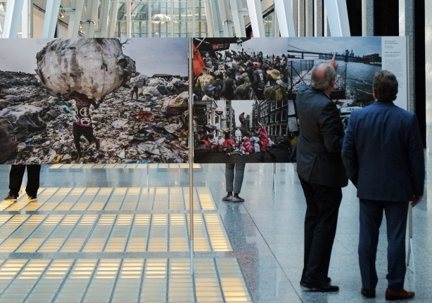 World press photo exhibit at Alan Lambert Galleria, two men looking at one of the photos, one man is pointing to something in that photo