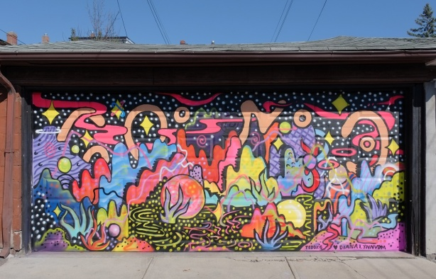 a wild mural with bright colours, shapes from nature, watery, and a black background by Ted and Diana